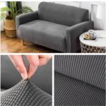 Foto de cobertor de sillones para la casa. Composición de microfibra y spandex en color gris.